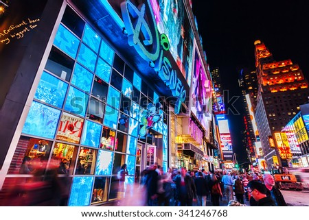 NEW YORK CITY - OCTOBER 08, 2015: Times Square at night with unidentified people. It is one of the worlds busiest pedestrian intersections and a major center of worlds entertainment industry - stock photo