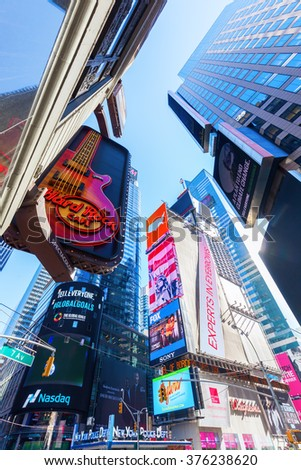 NEW YORK CITY - OCTOBER 06, 2015: Times Square in midtown Manhattan. It is one of the worlds busiest pedestrian intersections and a major center of worlds entertainment industry - stock photo