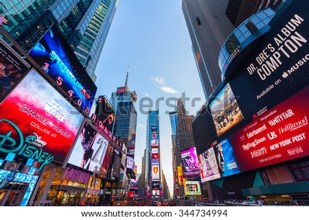 NEW YORK CITY - OCTOBER 13, 2015: Times Square with skyscrapers and neon advertisement. It is one of the worlds busiest pedestrian intersections and a major center of worlds entertainment industry
