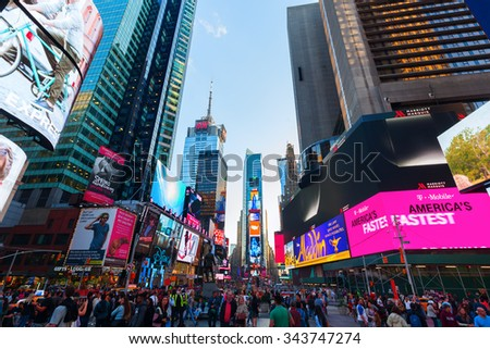 NEW YORK CITY - OCTOBER 13, 2015: Times Square with unidentified people. It is one of the worlds busiest pedestrian intersections and a major center of worlds entertainment industry - stock photo