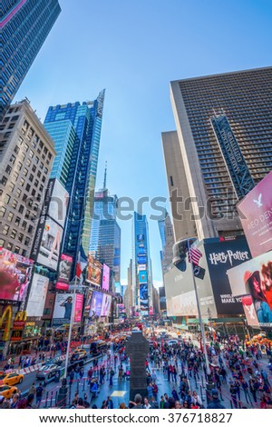 NEW YORK CITY - OCTOBER 10, 2015: Times Square with unidentified people. It is one of the worlds busiest pedestrian intersections and a major center of worlds entertainment industry
