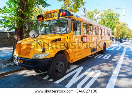 NEW YORK CITY - OCTOBER 07, 2015: typical NYC yellow school bus in Manhattan. School bus yellow is a color which was especially formulated for use on school buses in North America in 1939. - stock photo
