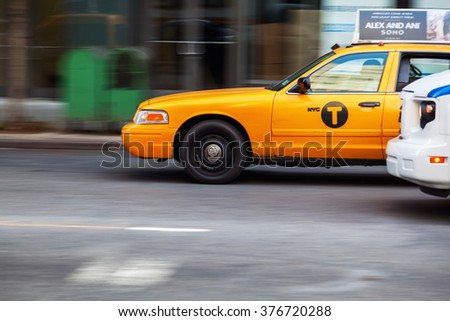 NEW YORK CITY - OCTOBER 08, 2015: yellow cab in Manhattan in motion blur. The taxicabs of New York City are widely recognized icons of the city - stock photo