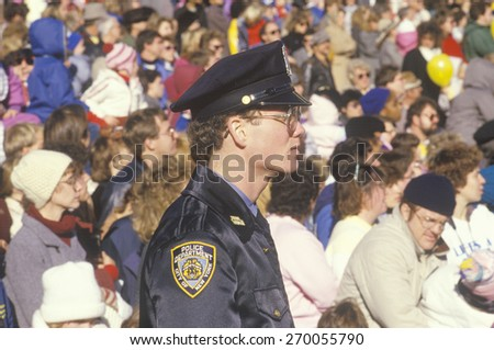 New York City Police officer observing Macy's Parade, New York - stock photo