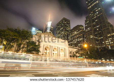 New York City Public Library at Night Long Exposure shot of blurred Bus - stock photo
