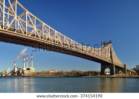 New York City - Queensboro Bridge and Ravenswood Generating Station. View from the Roosevelt Island. - stock photo