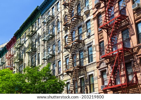 New York City row of colorful buildings in Manhattan - stock photo