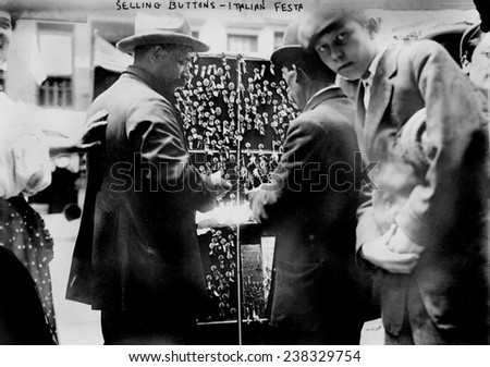 New York City, selling buttons at festival in Little Italy, circa 1908.