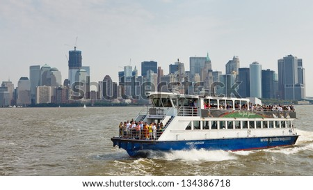 NEW YORK CITY - SEP 3: A ferry transports passengers from Manhattan across the Hudson River to New Jersey on September 3, 2011 in New York City. In 2011, NY Waterway transported 30,000 people per day. - stock photo