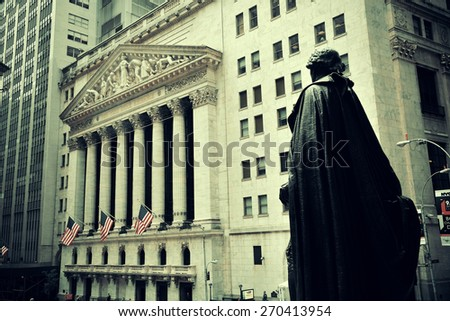 NEW YORK CITY - SEP 5: Wall Street with skyscrapers on September 5, 2014 in Manhattan, New York City. Wall Street financial districthas been called the world's principal financial center. - stock photo