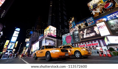 NEW YORK CITY - SEPT 18: Times Square, featured with Broadway Theaters, Taxi Cabs and animated signs, is a symbol of New York City and the United States, September 18, 2012 in Manhattan, New York City - stock photo