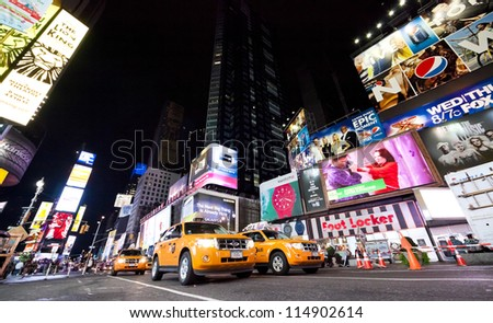 NEW YORK CITY - SEPT 26: Times Square, featured with Broadway Theaters, Taxi Cabs and animated LED signs, is a symbol of New York and the United States, September 26, 2012 in Manhattan, New York City - stock photo