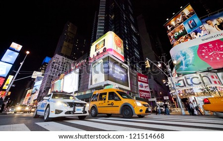 NEW YORK CITY - SEPT 25: Times Square, featured with Broadway Theaters, Taxi Cabs and animated LED signs, is a symbol of New York and the United States, September 25, 2012 in Manhattan, New York City - stock photo