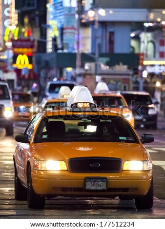 NEW YORK CITY - SEPT 17: Times Square, featured with Broadway Theaters, Taxi Cabs and animated LED signs, is a symbol of New York and the United States, September 17, 2012 in Manhattan, New York City - stock photo