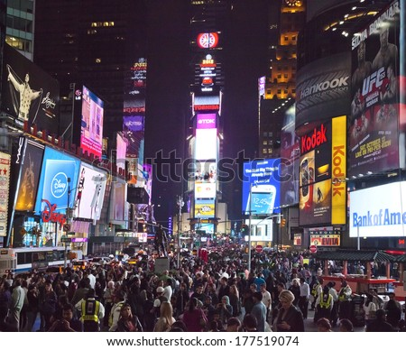 NEW YORK CITY - SEPT 28: Times Square, full of tourists from all the world's countries, featured with Broadway Theaters, Taxi Cabs and animated LED signs. September 28, 2012 in Manhattan, New York. - stock photo