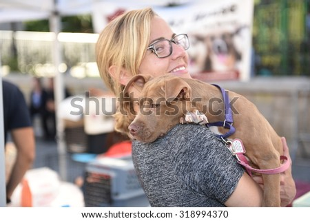 NEW YORK CITY - SEPTEMBER 20 2015: Adoptapalooza in Union Square Park brought numerous animal rescue organizations together under the big tent of the Mayor's Alliance for NYC Animals. - stock photo