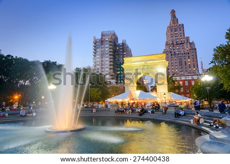 NEW YORK CITY - SEPTEMBER 12, 2012: Crowds gather at Washington Square Park. The historic park is popular in the summer. - stock photo