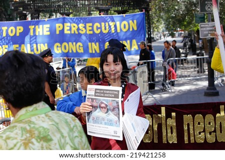 NEW YORK CITY - SEPTEMBER 23 2014: Falun Gong devotees gathered in Dag Hammarskjold Plaza during the UN Climate Summit to protest the Chinese government's alleged persecution of their movement
