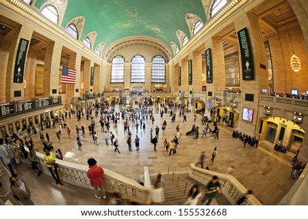 NEW YORK CITY - SEPTEMBER 22: Famous New York City landmark Grand Central Station (has more than 44 tracks and 67 platforms) full of tourists and commuters on September 22, 2013 in New York, New York - stock photo