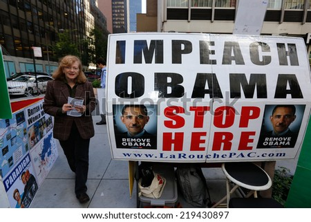 NEW YORK CITY - SEPTEMBER 23 2014: LaRouch PAC activists reach out to passersby on 3rd Ave soliciting donations, calling for  banking reform & President Obama's impeachment