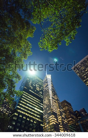 New York City - September 15: Manhattan evening view from Bryant Park to Bank of America Tower on 15 September 2015. - stock photo