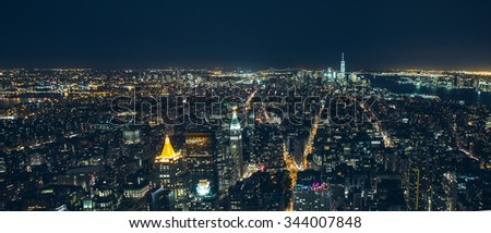 New York City - September 26: Manhattan night view from the Empire State bulding from the East River to the Hudson River and Madison Square in the middle panorama on 26 September 2015.