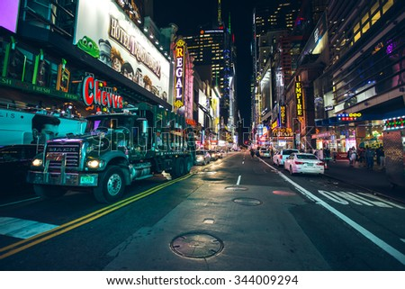 New York City - September 15: Manhattan night view traffic w 42nd st garbage truck on september 2015. - stock photo