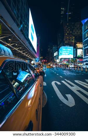 New York City - September 15: Manhattan night view traffic Yellow Cab reflecting advertisements  8th ave, 15 september 2015. - stock photo