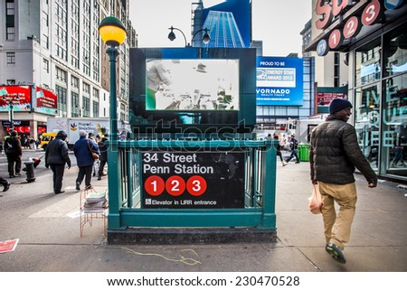 NEW YORK CITY - SEPTEMBER 12, 2013:  NYC Subway entrance at Penn Station in Midtown Manhattan seen from the sidewalk. - stock photo