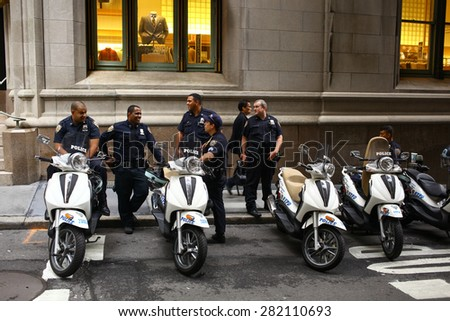 New York City - September 24, 2011: NYPD police officers share a laugh in Manhattan