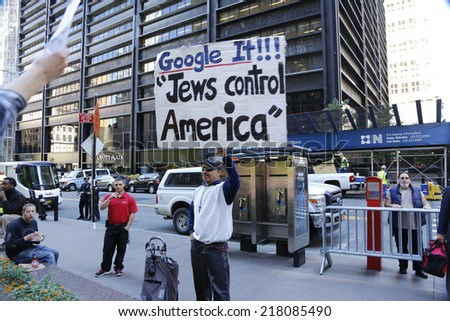 NEW YORK CITY - SEPTEMBER 17 2014: Occupy Wall Street marked the third anniversary of its founding as several dozen activists gathered in Zuccotti Park.David Smith with sign denouncing Jewish hegemony - stock photo