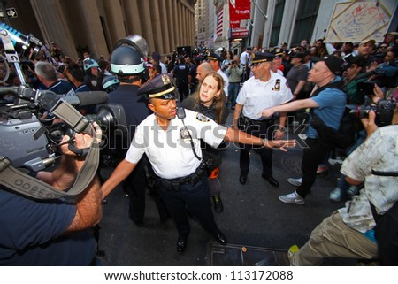 NEW YORK CITY - SEPTEMBER 17 2012: Occupy Wall Street marks its one year anniversary with a series of actions across Manhattan on September 17 2012 in New York City - stock photo