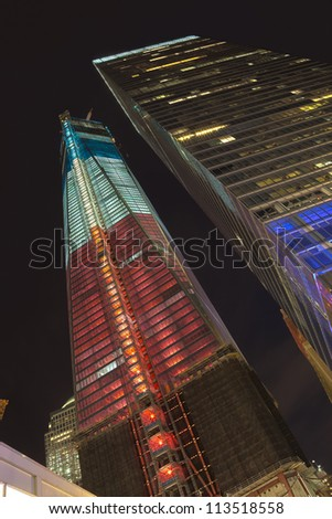 NEW YORK CITY - SEPTEMBER 17: One World Trade Center (known as the Freedom Tower) is shown under new  illumination on September 17, 2012 in New York, New York. - stock photo