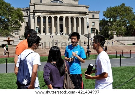 New York City - September 2, 2009: : Orientation leader (in blue tee-shirt) briefs a group of new students from China about life on campus at Columbia University