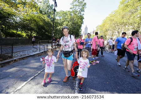 NEW YORK CITY - SEPTEMBER 7 2014: the annual Susan G Komen Foundation Race for the Cure filled Central Park West with thousands dedicated to raising funds & awareness for breast cancer research - stock photo