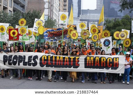 NEW YORK CITY - SEPTEMBER 21 2014: the People's Climate March in Manhattan brought several hundred thousand people for a march from Columbus Circle through Midtown calling attention to global warming - stock photo