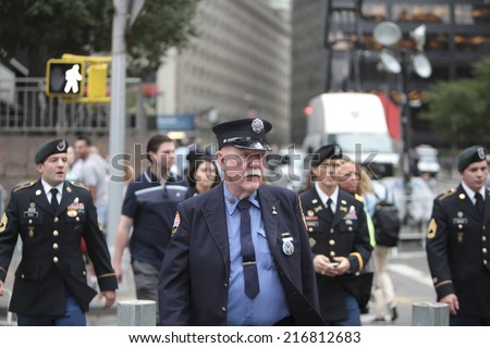 NEW YORK CITY - SEPTEMBER 11 2013: the 13th anniversary of the WTC terror attacks was observed in Lower Manhattan by first responders & relatives of attack victims. Senior firefighter arrives at site