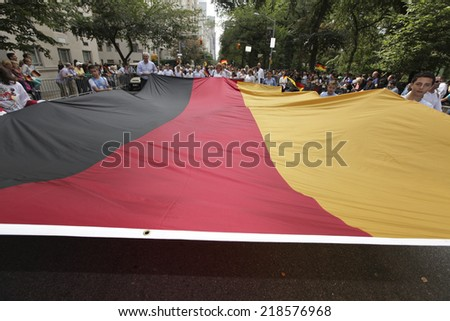 NEW YORK CITY - SEPTEMBER 20 2014: the 57th annual Steuben Parade is a celebration of German-American heritage held prior to the Central Park Oktoberfest. Massive German flag - stock photo