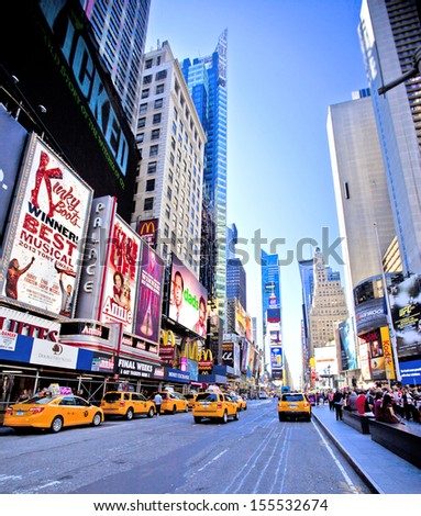 NEW YORK CITY - SEPTEMBER 22: Times Square, famous tourist attraction featured with Broadway Theaters and famous restaurant and store locations in New York City, September 22, 2013 in Manhattan, NYC - stock photo