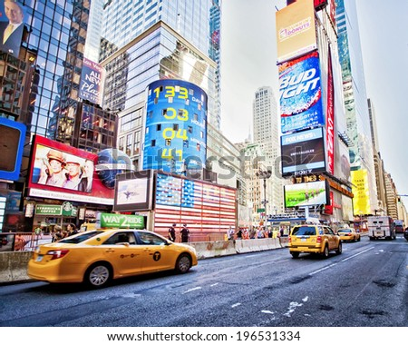 NEW YORK CITY - SEPTEMBER 22: Times Square, famous tourist attraction featured with Broadway Theaters and famous restaurant and store locations in New York City, September 22, 2013. - stock photo