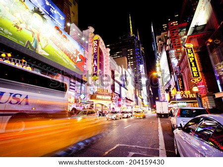 NEW YORK CITY - SEPTEMBER 22: Times Square, famous tourist attraction featured with Broadway Theaters and famous restaurant and store locations in New York City, September 22, 2013 in New York City - stock photo
