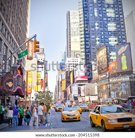 NEW YORK CITY - SEPTEMBER 22: Times Square, famous tourist attraction featured with Broadway Theaters and famous restaurant and store locations in New York City, September 22, 2013 - stock photo