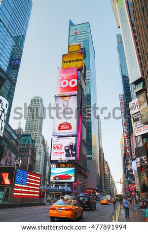 NEW YORK CITY - SEPTEMBER 04: Times square with people in the morning on October 4, 2015 in New York City. It's major commercial intersection and neighborhood in Midtown Manhattan