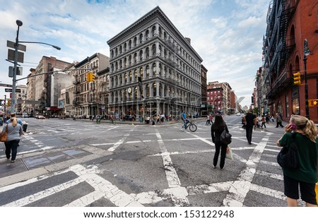 NEW YORK CITY - SEPTEMBER 22: Unidentified people walk and bike in Soho on September 22, 2011 in Manhattan, New York, NY - stock photo