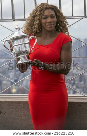NEW YORK CITY - SEPTEMBER 8: US Open 2014 champion Serena Williams posing with US Open trophy on the top of Empire State building on September 8, 2014  - stock photo