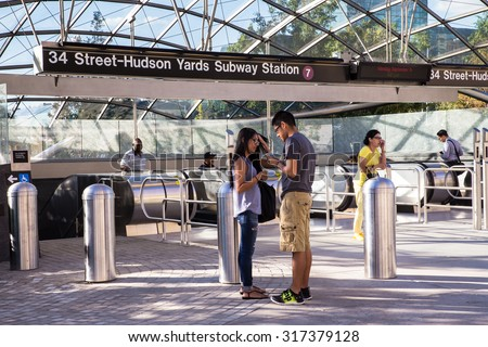 NEW YORK CITY - SEPTEMBER 14, 2015:  View of entrance to new Hudson Yards 7 train subway station which opened Sept. 2015 - stock photo