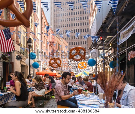 NEW YORK CITY - SEPTEMBER 17, 2016:  View of Oktoberfest 2016 along historic Stone Street in the downtown financial district of Manhattan.