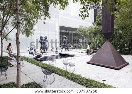 New york city, 12 September 2015: Visitors sit and walk in Sculpture garden of Moma New york city - stock photo