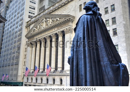 NEW YORK CITY - SEPTEMBER 27: Wall Street on September 27, 2014 in New York, NY. Wall St is the home of New York Stock Exchange, the world's largest stock exchange by market capitalization. - stock photo