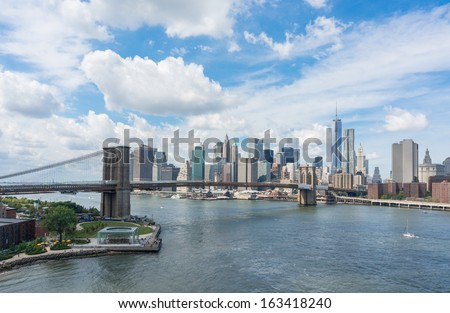 New York City skyline and Brooklyn Bridge - stock photo